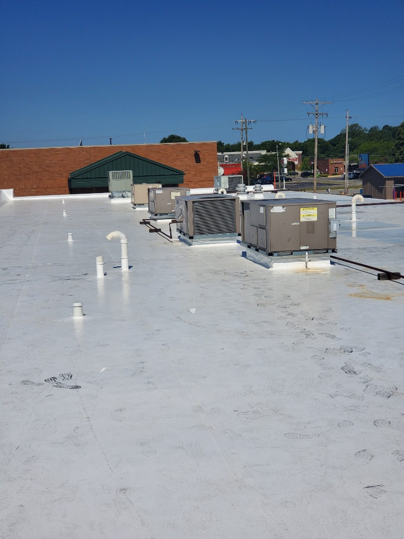 Kokomo, IN - Just finishing up a 14,000 square foot single-ply job in Kokomo, Indiana. We used 50 mill prefabricated Duro-Last deck sheets. We installed all new 2-piece compression metal around the entire perimeter.