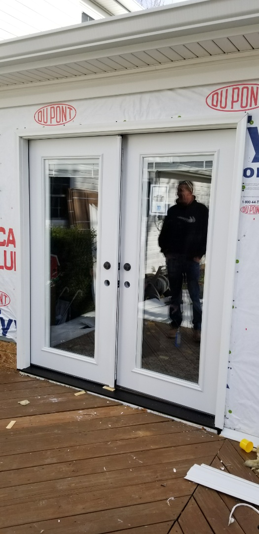 Marion, IN - Brand new ProVia French door being installed at our clients. There are no doors that compare to these for the price. The door is hand crafted, amish built in Ohio with only the best craftsmanship and materials. ProVia patented putting blinds in between the glass and still having Argon gas. They are the only ones that offer it and that sealed the deal for thus customer. The door is a beefy 20 gauge steel, has all new hardware and pocket as well as PVC coated brick mold for zero maintenance!