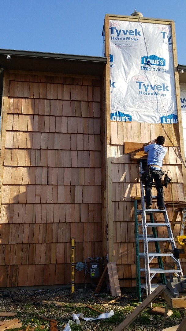 We are making fantastic progress on the Cedar Wood Shake install at our clients home. The trim work must be precise and takes a special trim carpenter to truly prepare the field shake. This siding install is rare, but beautiful. This style fits the clients architecture of the home and the client wanted a natural look that would last 50 plus years. Cedar siding and shake is a fantastic solution for that desire, with a customer that is ok with some maintenance every 5 to 10 years.