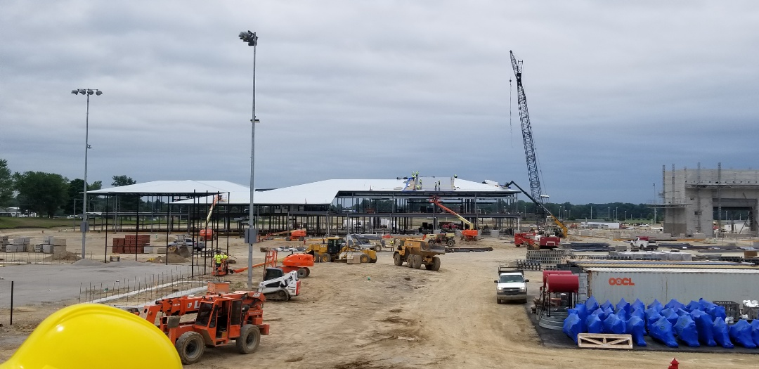 Here is an overview shot of the Columbia city High School with a PVC roof being installed with welded ribs to appear as Standing Seam Metal roof. Honored to be part of the project out here. Columbia City will have a state of the art High School with the project close to breaching $400 million dollars.