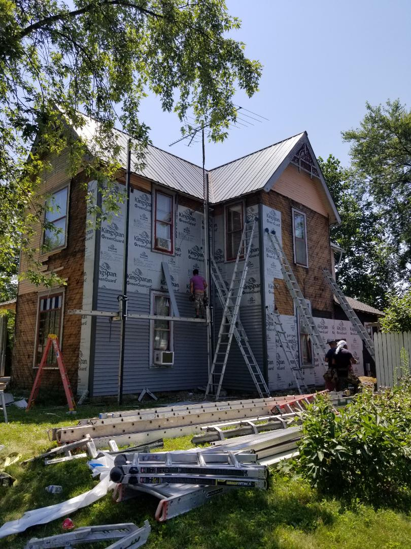 Converse, IN - Full siding rear off on old Victorian-era house. Installing new Mastic Quest foam-back siding.