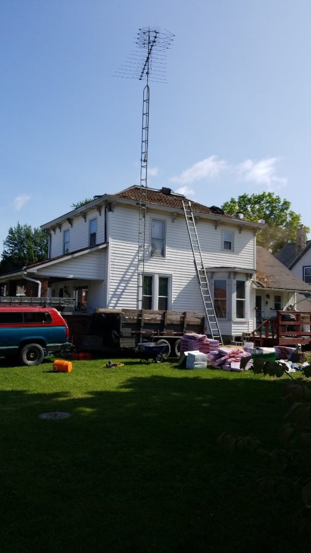 4 layer tear off with cedar shakes.  Full re-deck with Owens Corning estate grey shingles