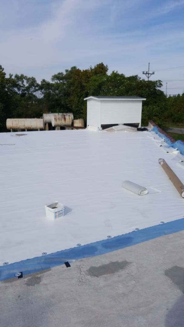 Marion, IN - Installing 50 mill white Dura-Tuff over old built-up roof system.