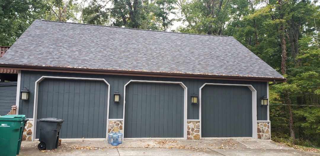 Marion, IN - Our customer Loves the new colors on the detached garage! The original brown siding and roof was quite dated, with the last update being in the 70s. Kingdom Construction modernized the garage by installing a new Malarkey Class 4 impact resistant shingle roof with a Black Oak color and painting the siding Iron Gray and the trim Pearl gray to match the new James Hardie siding we are installing on the home. We are making the home maintenance free and modernizing the look. #KingdomCulture