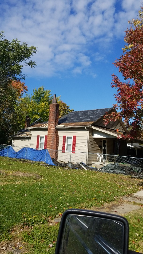 Marion, IN - 4-layer tear off. Going back with Owens-Corning oakridge laminated shingles.
