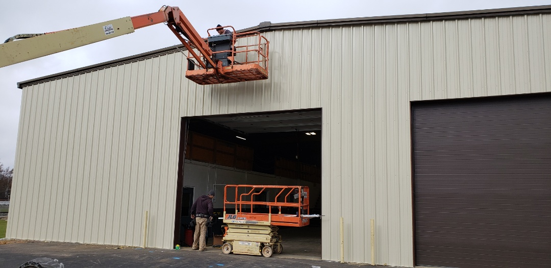 Marion, IN - Our Kingdom Construction Commercial Crew is making great progress on the Marion Utilities maintenance barn. The barman had undersized overhead doors bot allowing the new trash trucks to enter doe maintenance. Our commercial crew has fabricated new rough opening from small guage steel angle, installed new commercial Overhead Doors, installed new siding and new door openers. Tomorrow we will wrap up with new bollard posts to safeguard the corners and doors. #KingdomCulture