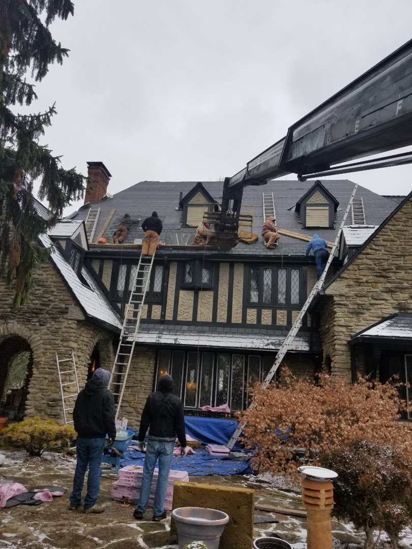 """The guys hard at work today finishing up an Owens-Corning Berkshire shingle installation.  This has been a challenging job to say the least. The roof is a 16/12 pitch and 2-story.  Most companies would run from this job, but we like the """"tough ones""""."""