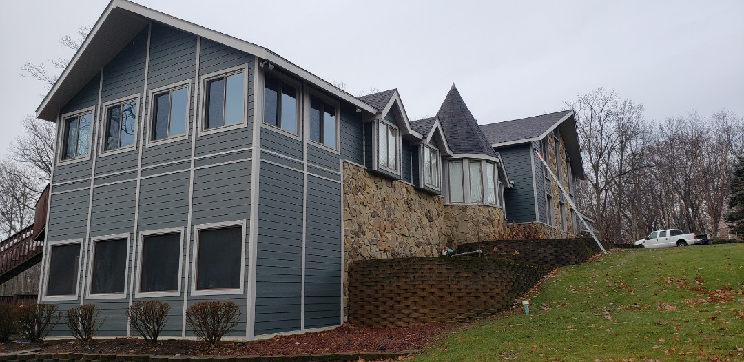 Marion, IN - This James Hardie install was a complete renovation outside. This homeowner lives on a lake and has massive pressure from nature all year round. The homeowner had cedar siding from the 80's and fought woodpeckers, wood boring bees, rodents eating away at the siding from the roof and accessing the attic, as well as bats finding entry through knot holes that had fell out. The homeowner received a bid for painting and we installed all new Hardie for the same price as 3 paint jobs. Great value!
