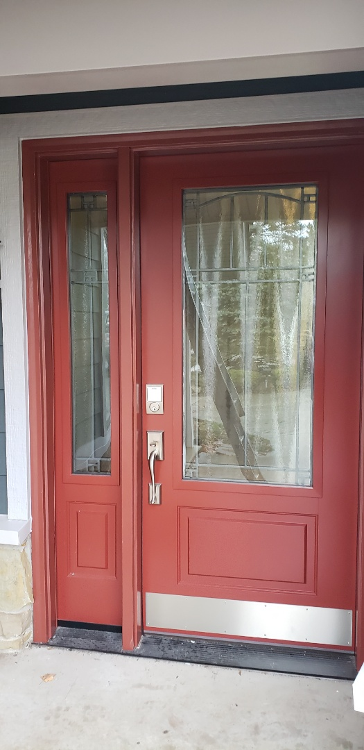 What a gorgeous entry door by ProVia! This fiberglass door will outlive the home. The frame is made of composite and will never rot, bow, break or be worked by bugs. We installed multiple digital entry key oads throughout the home so the homeowner never needs to worry about being kicked out. We also love the specialty glass that was chosen. This frost stops the view but allows kight to come in and gives off really neat colors. This door is a statement and you deserve one too! #KingdomCulture