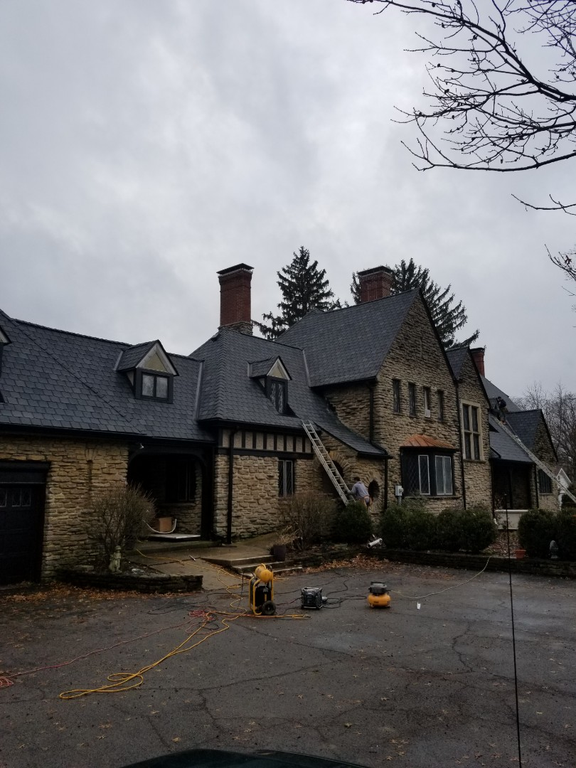 Finishing up a tough one!!!! We installed Owens-Corning   Berkshire lifetime laminate shingles on this job in Muncie.  It was a 16/12 pitch with 54 different roof planes.  We are finishing up installing James Hardi stucco panels on all the dormers.