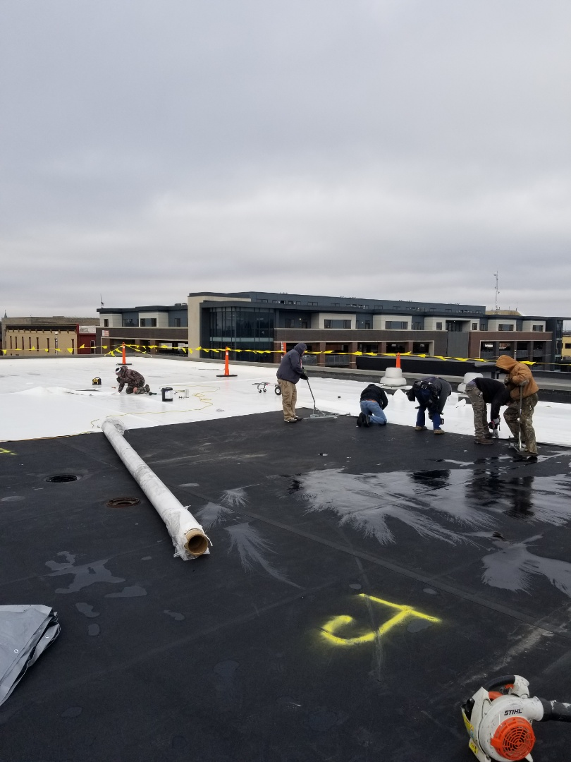 Kokomo, IN - Installing 60 mill Duro-Last single-ply mechanically fastened membrane on Kokomo city hall building. Excellent year-round product that can be installed at any temperature. Duro-Last can be mechanically fastened so we dont rely on glue/adhesives (very temperature specific) like you would with an EPDM roof. All the seams are welded with a robot/hand welder giving us a totally seamless roof! Call Kingdom today with your commercial roofing needs!