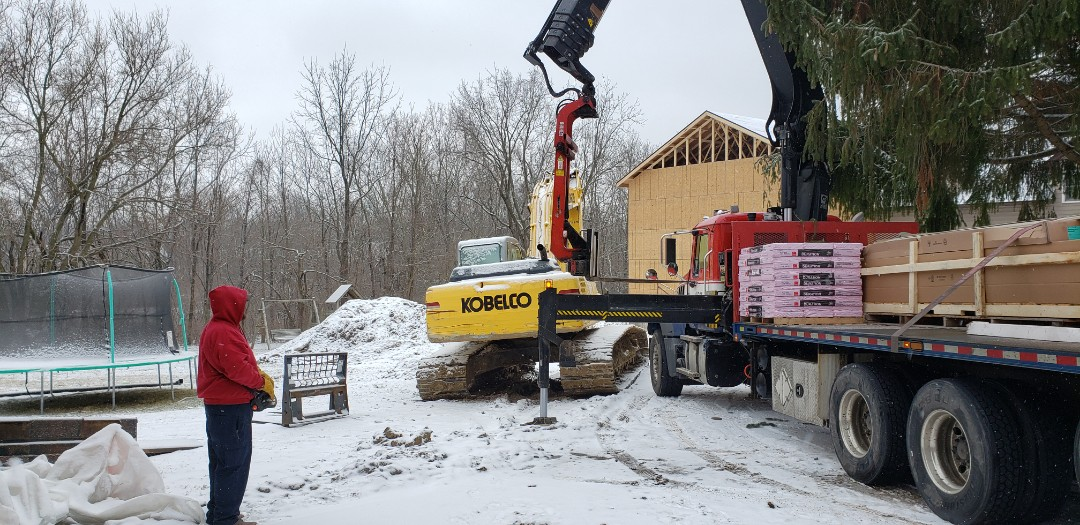 Marion, IN - Rain, snow or shine.... Kingdom Construction will Make sure our customers are taken care of. This customer is building an addition to their home and is concerned that the new OSB deck over the roof will get water damaged from snow and rain. Kingdom got the call Friday afternoon about the problem and we are here first thing Monday morning to make sure they get dried in. Safety is first and if the deck is too slick to shingle, we will rope and harness to at least get underlayment on and protect the OSB.