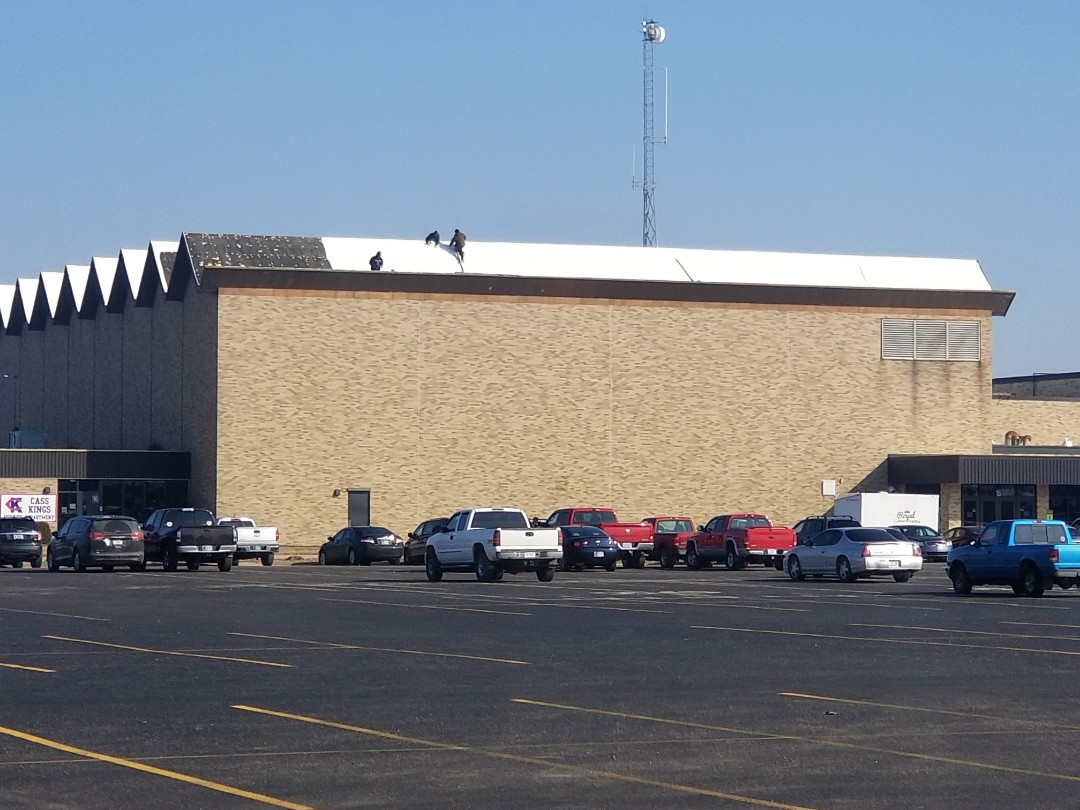 Walton, IN - The crew is hard at work on an emergency service call at Lewis-Cass High School. A large section of membrane was blown-off this weekend.  We are tarping over 10,000 square feet of roof surface. Call Kingdom Construction for any of your  roof needs!