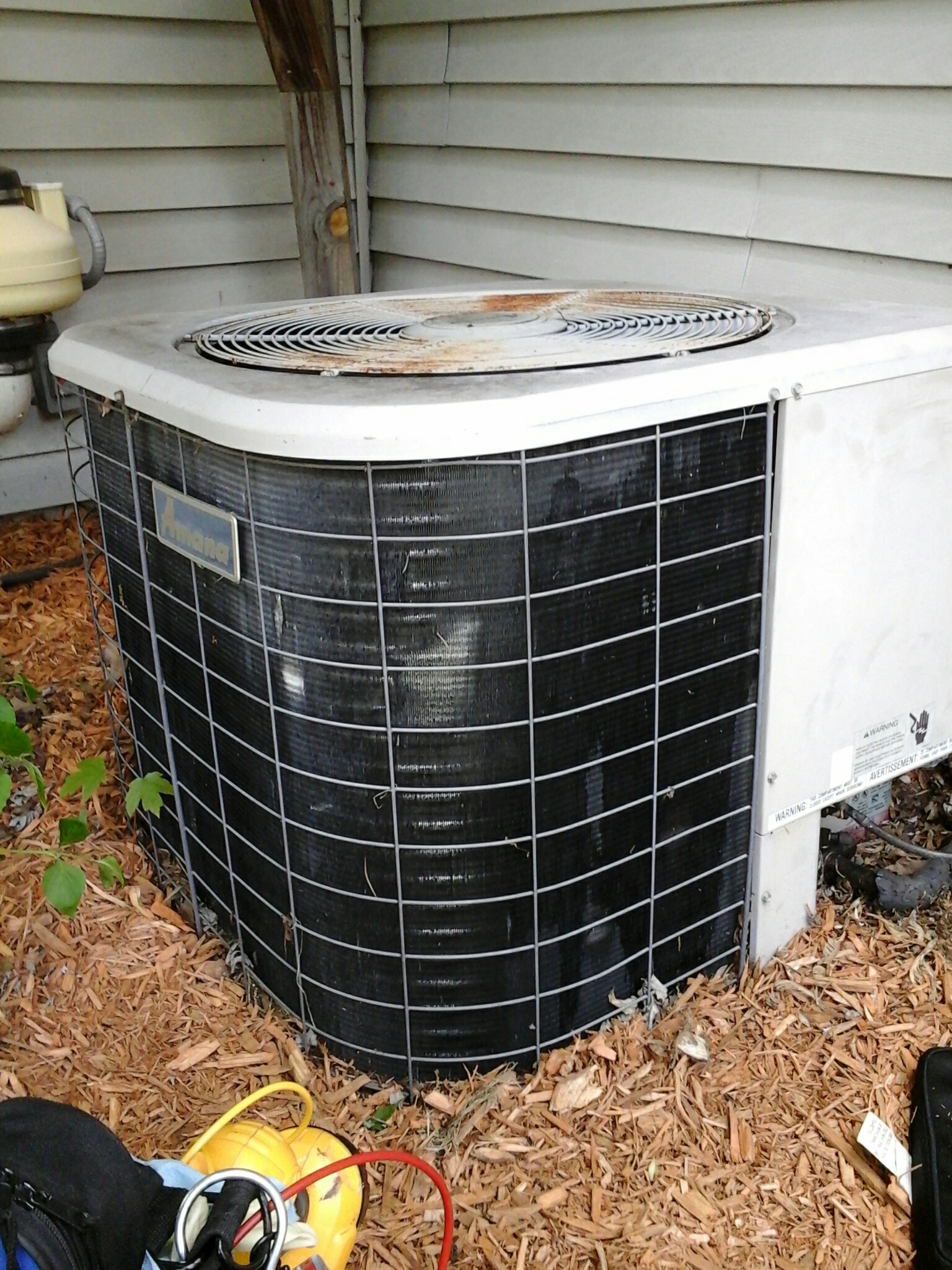 Concord, MI - Performed a precision tune-up on an Amana P120 air-conditioning unit for a comfort club member.