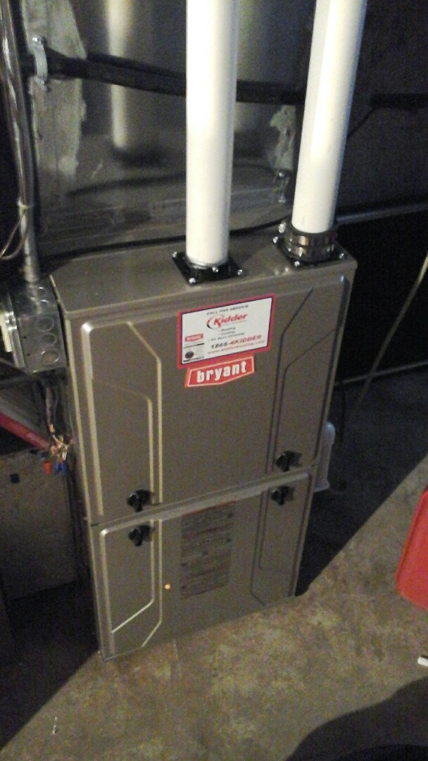 Olivet, MI - Performed a precision tune-up on a Bryant 926TA 90% furnace with a 20 x 20 � 4 media air filter.