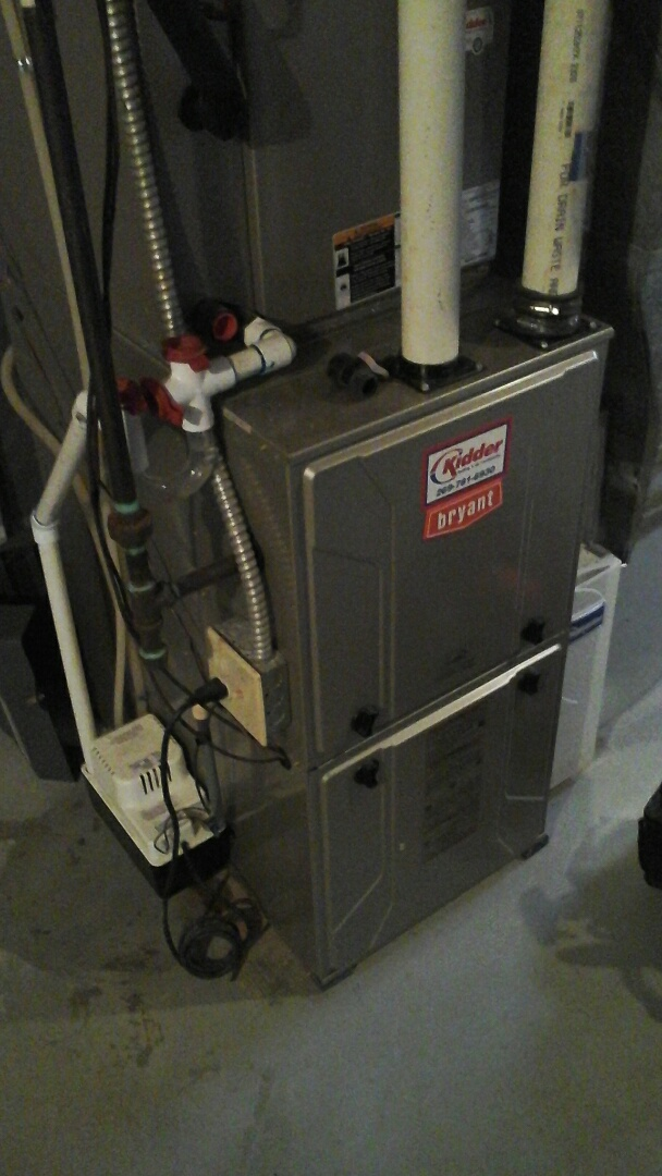 Battle Creek, MI - Yearly maintenance tune-up on a high efficiency Bryant furnace with a 16 � 20 � 1 pleated air filter and condensate pump.