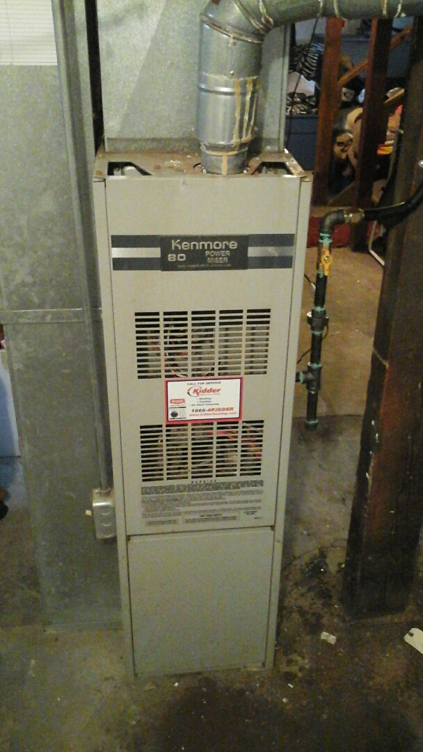 Battle Creek, MI - Cleaning of draft vent and chimney on a 80% Kenmore furnace.