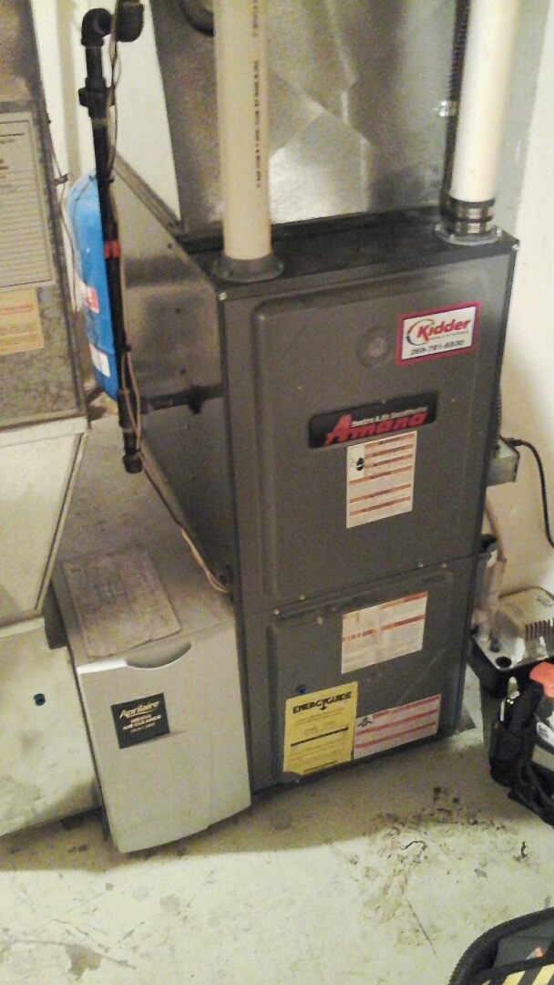 Battle Creek, MI - Yearly maintenance tune-up on  a high efficiency Amana AMH furnace with a #401 media air filter and condensate pump.