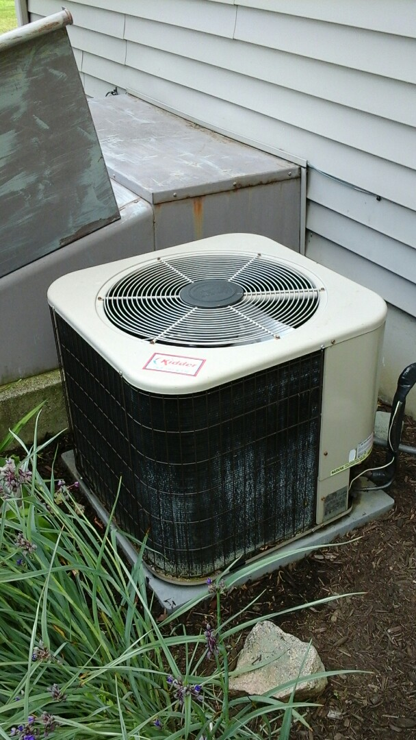 Albion, MI - Yearly maintenance tune-up on a Amana RCB air conditioning unit with R - 22 refrigerant charge and the replacement of the dual run capacitor device.