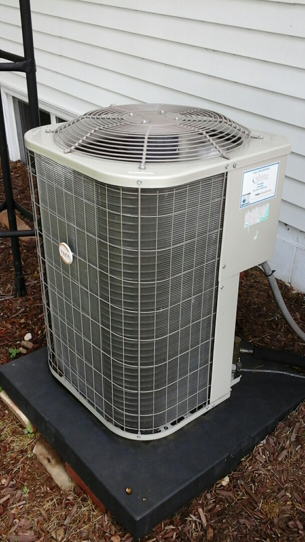 Marshall, MI - Yearly maintenance tune-up on a Payne air conditioning unit with R410A refrigerant charge and a #213 Aprilaire media air filter and condensate pump.
