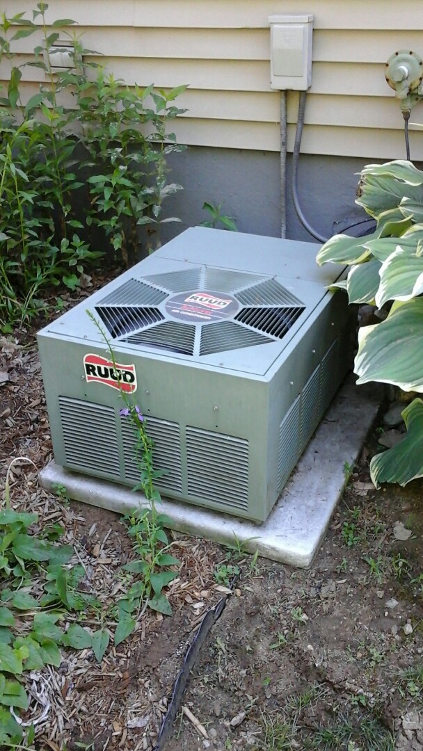 Athens, MI - Yearly maintenance tune-up on a Ruud air conditioning unit with R - 22 refrigerant charge.