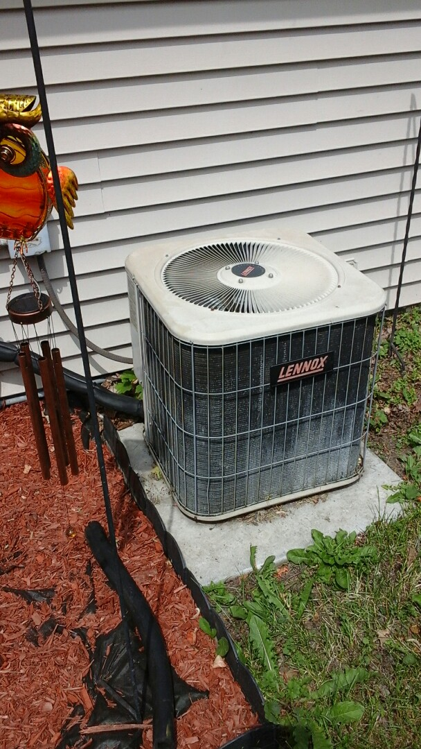 Union City, MI - Yearly maintenance tune-up on a Amana RCB air conditioning unit with R - 22 refrigerant charge and replacement of the start capacitor.