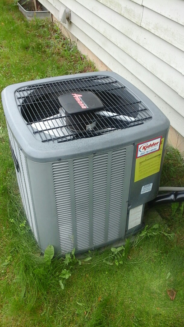 Albion, MI - Yearly maintenance tune-up on a Amana ASX air-conditioning unit with R410A refrigerant charge and replaced the start capacitor device with a 20 x 20 � 1 fiberglass air filter and condensate pump.