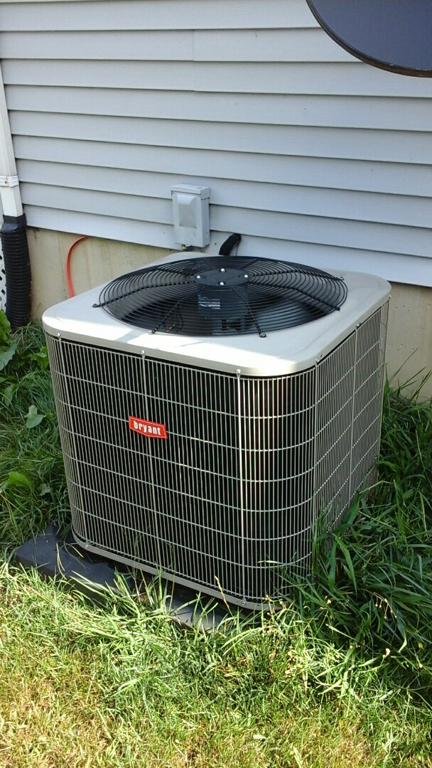 Bellevue, MI - Yearly maintenance tune-up on a Bryant Legacy air-conditioning unit with R410A refrigerant charge and a #401 Aprilaire media air filter.