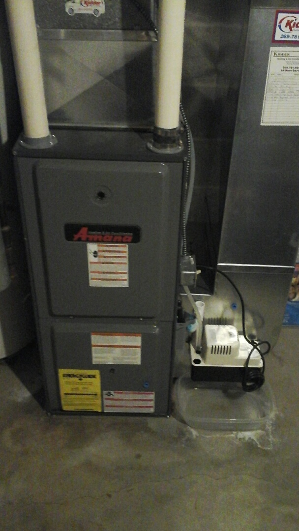 Homer, MI - Yearly maintenance tune-up on a Amana AMH, condensing furnace with a 16 � 20 � 1 pleated air filter and condensate pump with EZ-TRAP drain system lines and HSI ignitor.