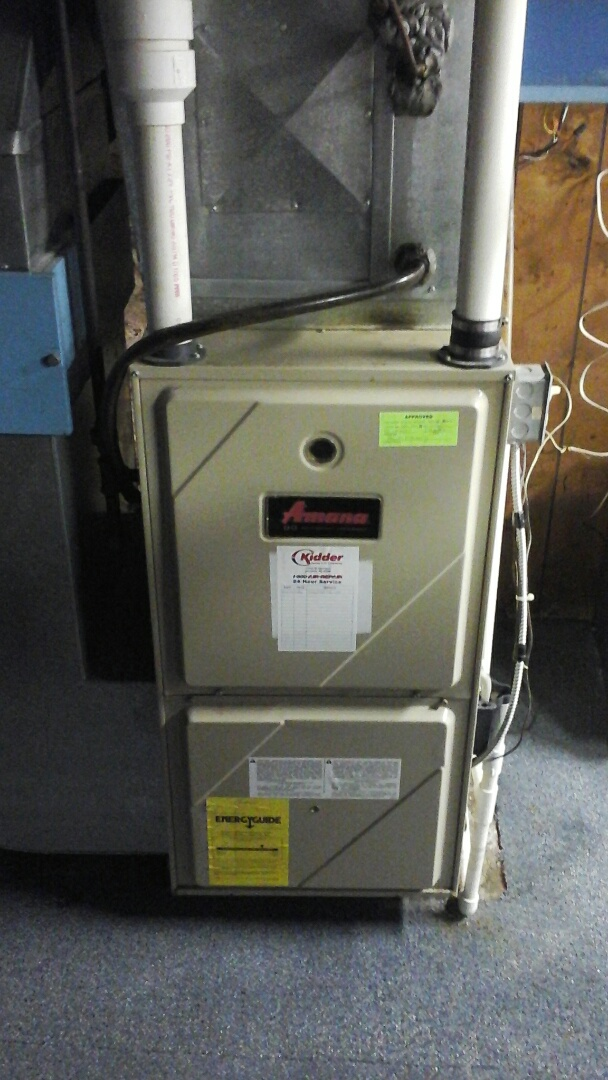 Tekonsha, MI - Yearly maintenance tune-up on a Amana GUI furnace with a #401 Aprilaire media air filter and HSI ignitor.