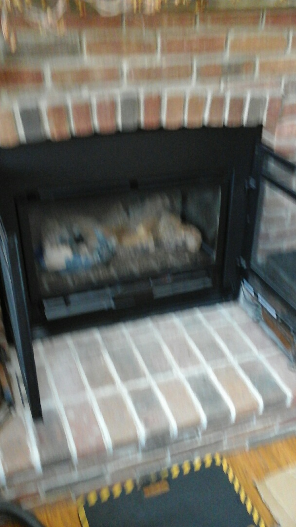 Olivet, MI - Yearly maintenance tune-up on a Heat N Glo fireplace gas insert.