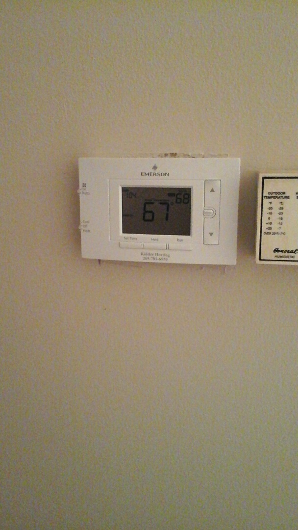 Concord, MI - Diagnostic of a white Rodgers, five-function thermostat.