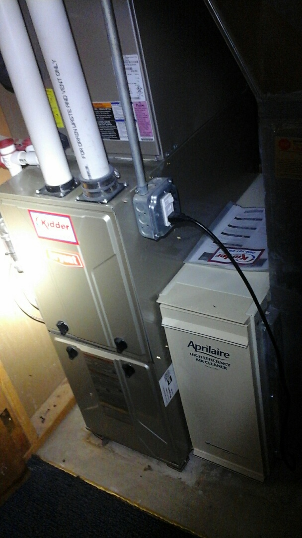 Albion, MI - Yearly maintenance tune up on a Bryant condensing furnace with a #201 air filter and condensate pump.