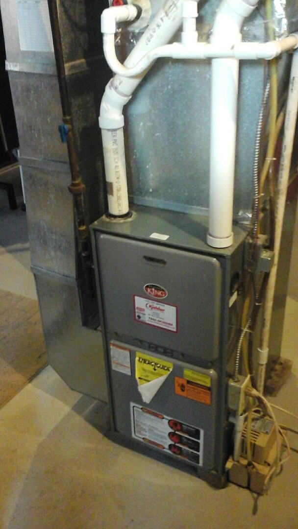 Ceresco, MI - Cleaning and testing of the flame rectification sensor on a Rheem furnace.