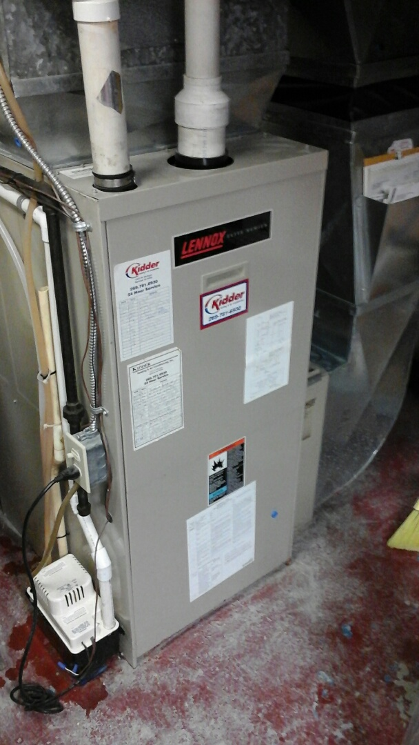 Olivet, MI - Installation of the induced draft motor on a 90% efficient, condensing, Lennox gas furnace.