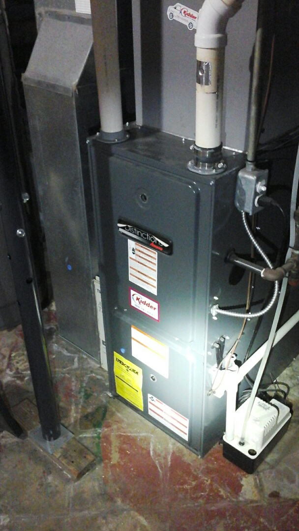 Battle Creek, MI - Yearly maintenance tune-up on a high-efficiency Amana gas furnace with a 16 � 25 � 3 media air filter and condensate pump.