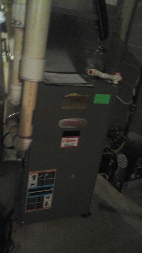 Battle Creek, MI - Yearly maintenance tune up on a Lennox furnace with a 16 x25 x4 media air filter, and condensate pump.