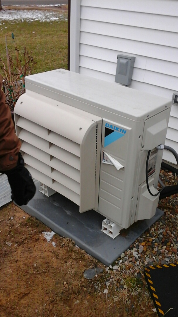 Battle Creek, MI - Cleaning of the air filters on a Daikin heat pump.