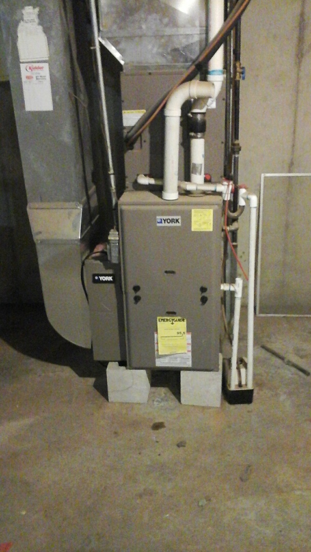 Marshall, MI - Replacement of the five-function programmable thermostat and 20 � 25 � 5 media air filter on a high-efficiency York gas furnace.