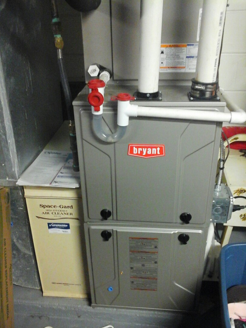 Battle Creek, MI - Yearly maintenance tune up on a Bryant condensing furnace with a #213 filter and condensate pump.