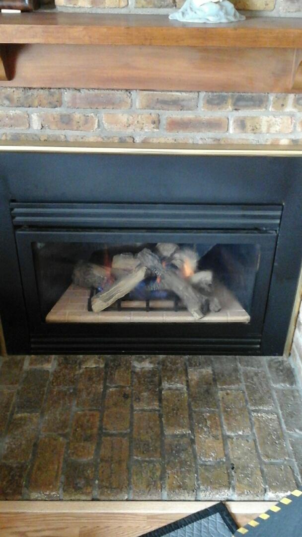Marshall, MI - Yearly maintenance tune-up on a gas logset fireplace.