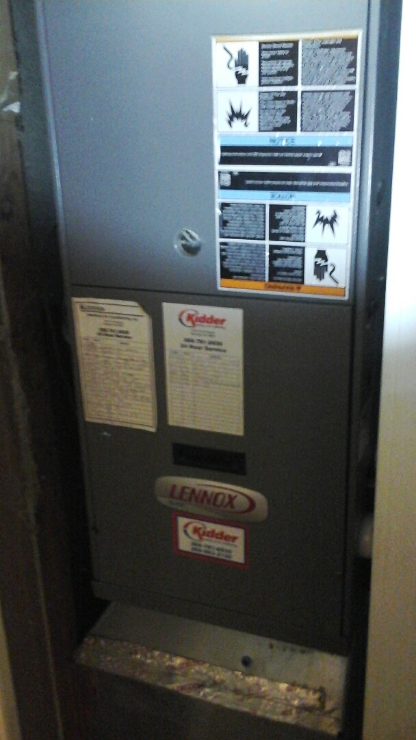 Albion, MI - Yearly maintenance tune-up on a high-efficiency Lennox gas furnace with a model 2400 Aprilaire media air filter and bypass humidifier with a condensate pump.