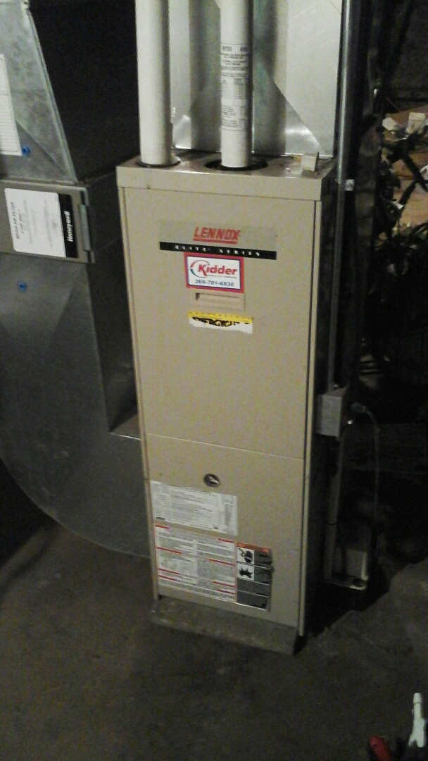 Ceresco, MI - Replacement of the induced draft fan motor on a high-efficiency Lennox, gas, furnace.