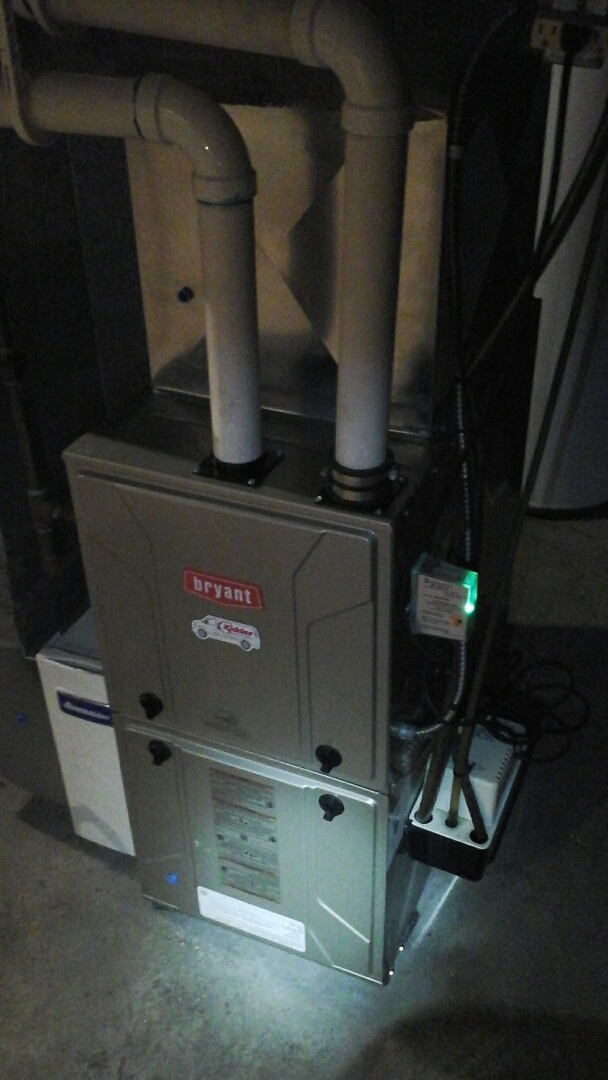 Ceresco, MI - Installation of a new surge protector on a high-efficiency, condensing, Bryant gas furnace.