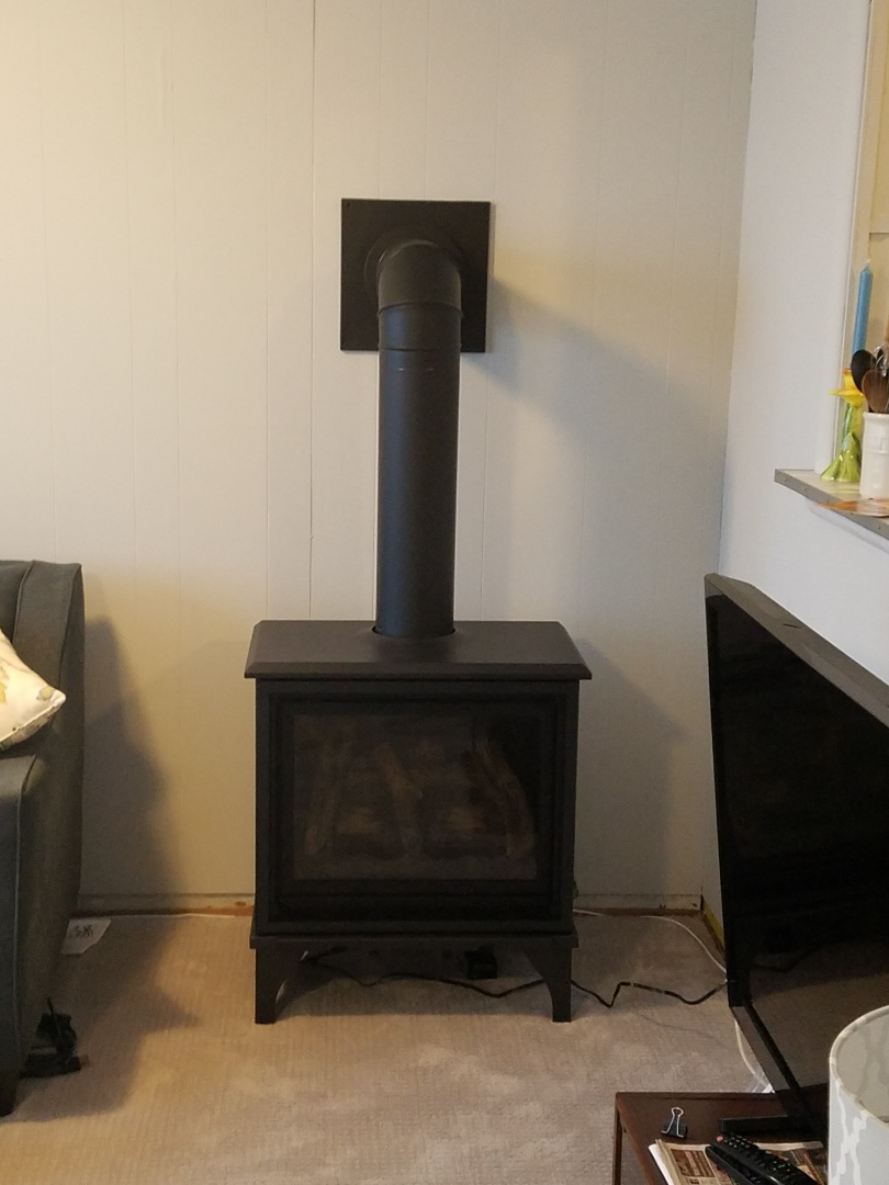 Olivet, MI - Wall Furnace and wood stove/furnace.
