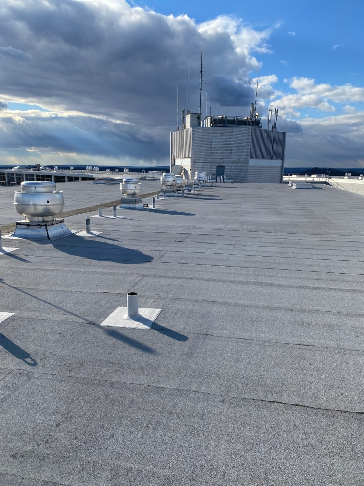 Verona, NJ - Measuring a commercial roof and skylights for full replacement