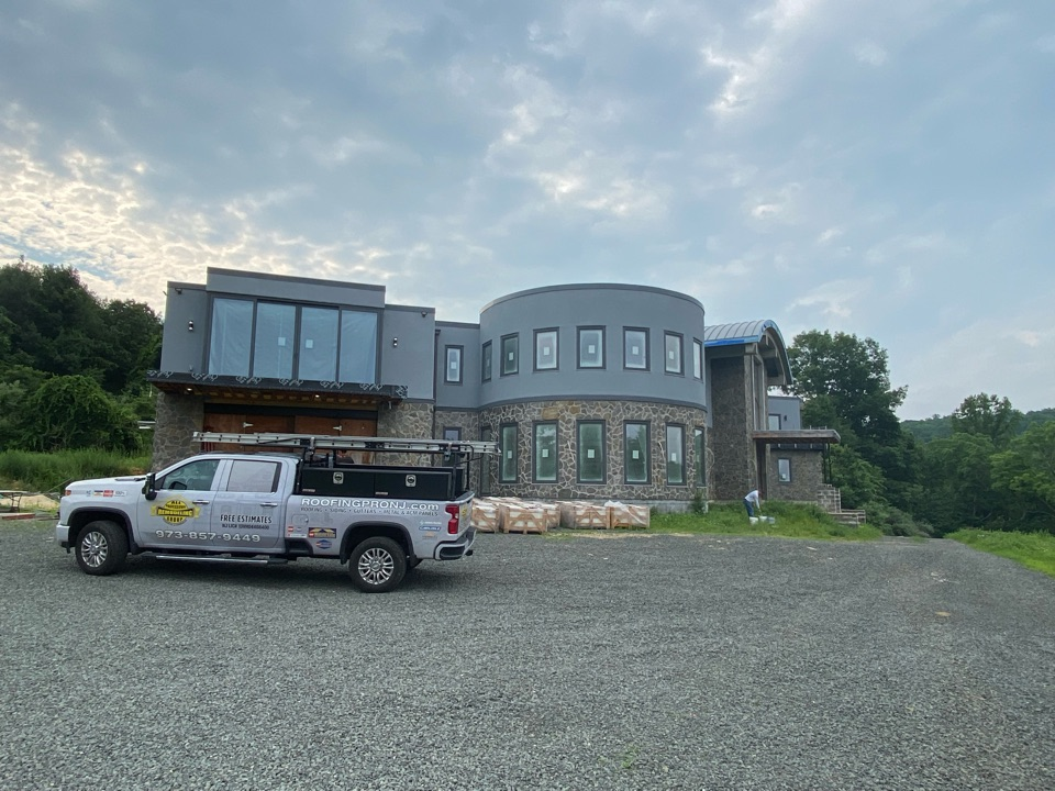 Long Valley, NJ - Installing new Englert Standed seam metal roof on this beautiful new construction home.