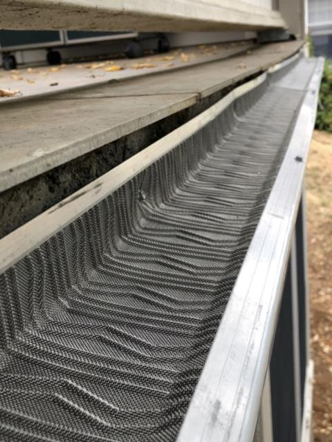 Cotati, CA - Great close up look at our micro-mesh gutter protection system on this Cotati install today. Micro-mesh is a great cost-effective alternative to Gutter Helmet if you're looking to keep out light debris and work within a budget!