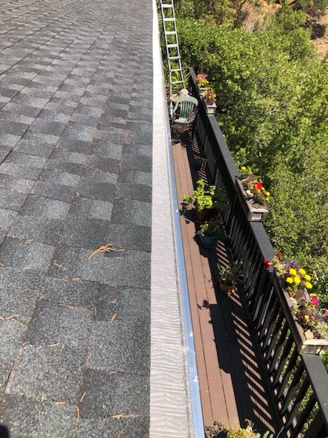 Mill Valley, CA - Another great Mill Valley install! This residence is protected with black seamless 5-Inch fascia gutters, 90 ft of stainless steel Micro Mesh, and  galvanized downspouts. Micro Mesh is a great option for those looking for a cost-effective way to fend off light debris!
