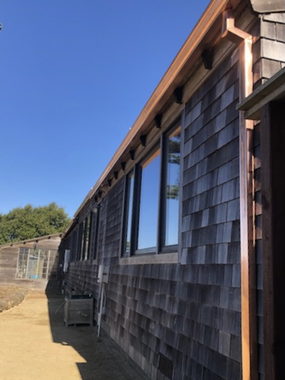 Point Reyes Station, CA - Here's some gutters we don't install everyday: 130 feet of shining copper gutters with 50 feet of matching downspouts. This beautiful Point Reyes residence is protected in style!